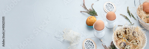 Obraz Easter composition with eggs and colorful sweets on light gray background. - fototapety do salonu