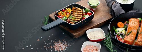 Fototapeta Homemade fresh salmon with starter and vegetables on dark background obraz