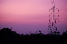 Silhouette Of Transmission Towers In The Countryside At
