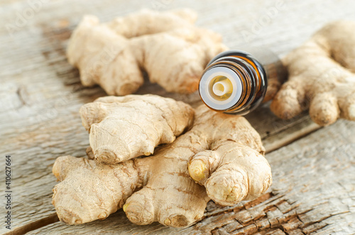 Fotografia, Obraz Small bottle with essential ginger oil ( extract, tincture, infusion, perfume)