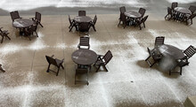 A Patio Is Covered With A Light Snow