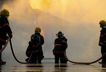Firefighters Spraying High Pressure Water To Fire Burning Fire Flame Background