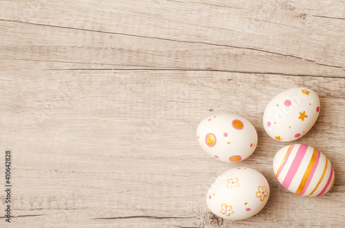 Obraz Colorful perfect handmade painted easter eggs on a wood background. - fototapety do salonu