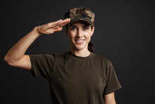 Happy Beautiful Soldier Woman Saluting And Smiling At Camera