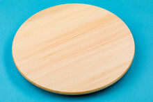 Bamboo Or Wooden Rotating Tray, On A Blue Background.