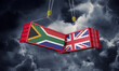canvas print picture - UK and South Africa business trade deal. Clashing cargo containers. 3D Render