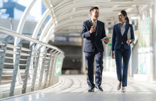 Business People Walking And Talk To Each Other In Front Of Modern Office