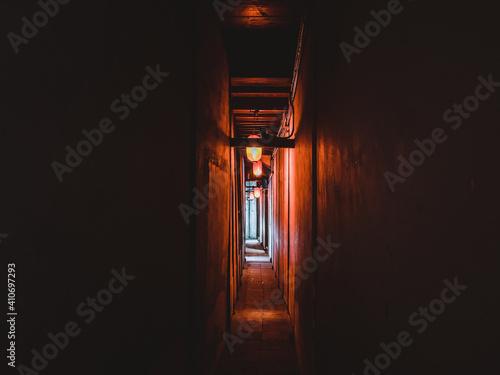 Narrow dark corridor illuminated with Chinese style lanterns Poster Mural XXL