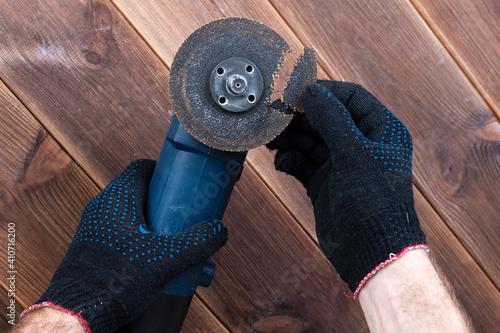 Obraz na plátně A grinder with a broken blade on a wooden table