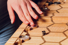 Playing Backgammon Game. Man Play Board Game. Dice On Wooden Board.