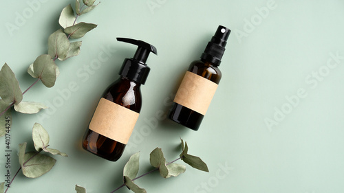 Fényképezés Organic natural cosmetic products with eucalyptus leaves on green background