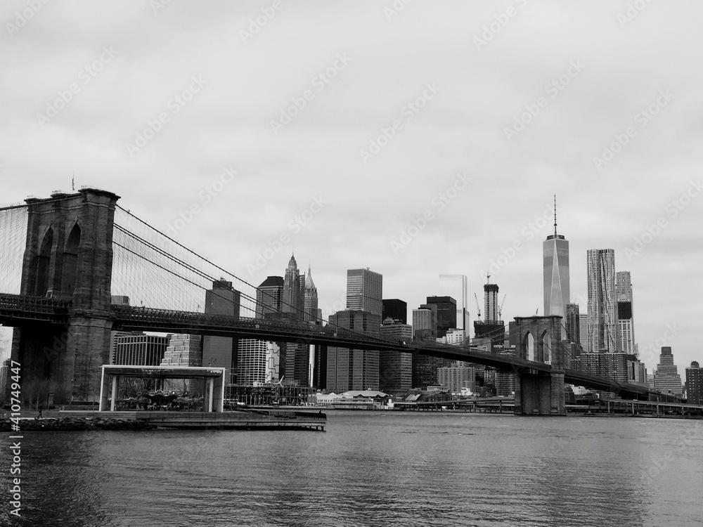 Brooklyn Bridge Over River Against Buildings In City