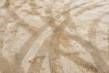 Tire Tracks On Wet Sand In The Mojave Desert