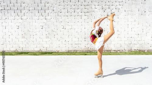Obraz na plátne Teenage girl practicing figure skating on four wheels