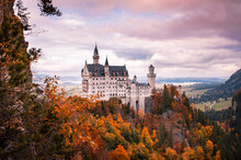 Mesmerizing View Of The Neuschwanstein Castle On A Hill With Autumn Mountains In Schwangau, Germany