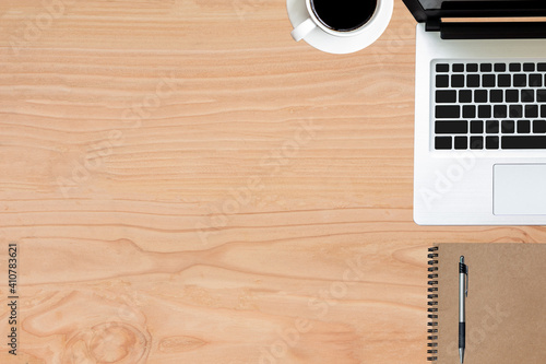 Fototapeta High Angle View Of Technology With Coffee By Book And Pen On Wooden Table obraz