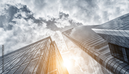 Low Angle View Of Skyscrapers Against Cloudy Sky
