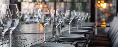 Cuadros en Lienzo Modern veranda restaurant interior, banquet setting, glasses, plates