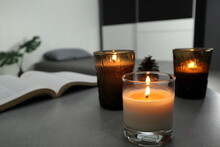Luxury Lighting Aromatic Scented Candles And A Book Is On The Grey Table To Creat Romantic And Relax Ambient In The Grey Bedroom With Background Of Grey Bed And Pillow On Valentine Day