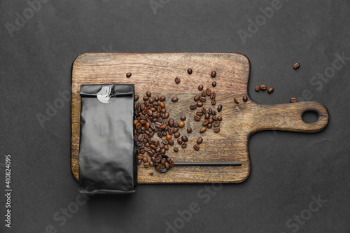 Board with coffee bag on dark background © Pixel-Shot