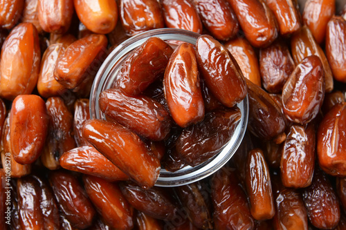 Fototapeta Glass bowl on sweet dried dates