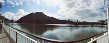 Panoramic View Of River By Mountains Against Sky