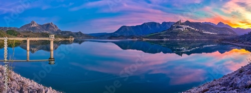Panoramic View Of Lake And Mountains Against Sky During Sunset