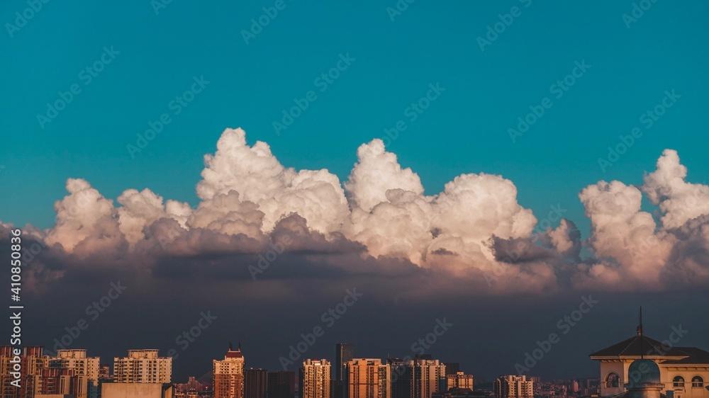 Fototapeta Low Angle View Of Buildings Against Blue Sky