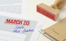A Red Stamp On A Document - March 20