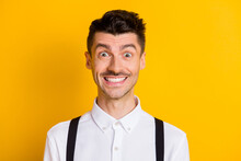 Close-up Portrait Of Nice Funny Cheerful Guy Wearing White Shirt Smiling Isolated Over Bright Yellow Color Background