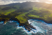 Aerial View Of The Atlantic Ocean Rough Sea Waves Crashing On The Rocks On The Terceira Island. Azores Archipelagos, Portugal.
