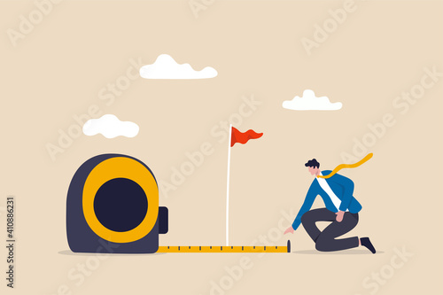 Obraz Business success measurement, how far from business goal and achievement or growth metric analysis concept, smart businessman using measuring tape to measure and analyze distance from target flag. - fototapety do salonu