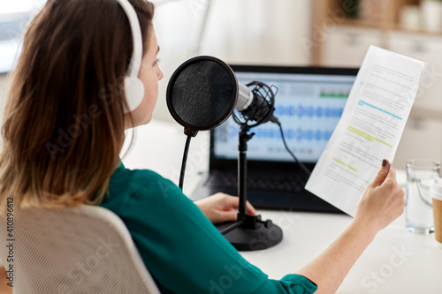Fotografia, Obraz technology, mass media and people concept - close up of woman with microphone an