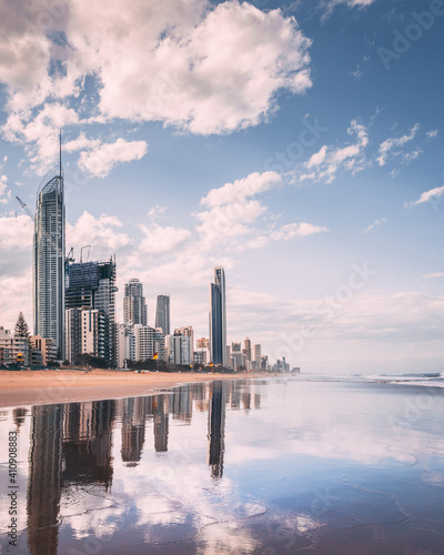 Fotografie, Obraz Vertical shot of a beach in the background of highrise buildings in Goldcoast, A