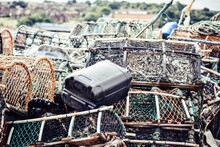 Lobster And Crab Pots Traps Stacked On Harbour. Fishing Industry In Whitby, England, United Kingdom.