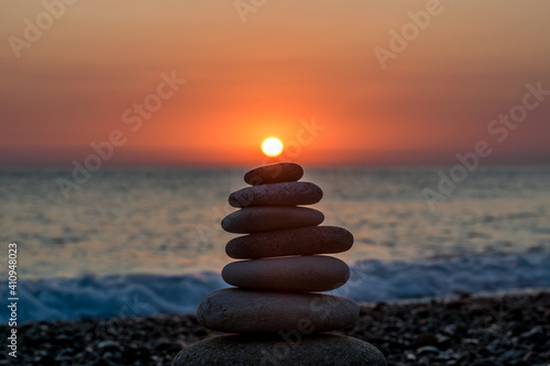 Stack Of Stones At Beach During Sunset - fototapety na wymiar