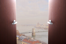 Travel And Tourism. Sale Of Tours, Airline Tickets. Doors Swing Open Overlooking The Danube River In Budapest, Hungary