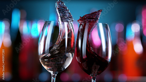 Two glasses of red and white wine hitting each other