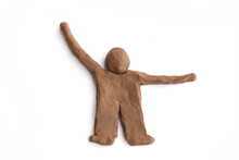 Figurine Of Natural Clay  Isolated On White Background.  Doll Man Of Wet Clay Material For Sculpting Or Modeling..