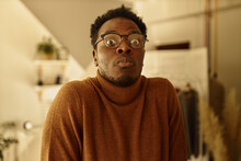 Oh My God. Emotional Confused Young Dark Skinned Man In Eyeglasses Having Forgetful Look, Realizing That He Did Something Wrong, Posing Indoors, Expressing Puzzlement, Confusion And Uncertainty