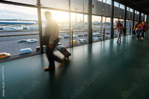 Fototapeta Blurred people walking at airport terminal - Travel and transportation concept d