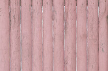 The Background Of The Fence Is Pink Old Wooden.