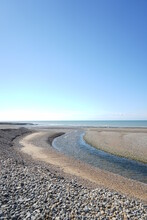 Surface Level Of Beach Against Clear Blue Sky