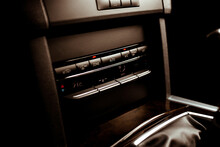 Beautiful And Clear Interior Details Of The Mercedes E-Class. Pictures Of The Steering Wheel, Gear Stick, Armrest And Climatronics.