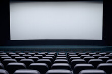 Cinema Hall With White Screen And Black Chairs.