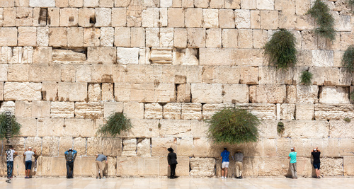 Canvas-taulu Jerusalem, Israel - August 20, 2020 -Jewish orthodox believers reading the Torah and praying facing the Western Wall, also known as Wailing Wall in the old city in Jerusalem, Israel