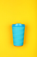 Blue Paper Coffee Cup Over Yellow