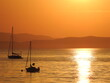 Leinwandbild Motiv Silhouette Boats In Sea Against Orange Sky