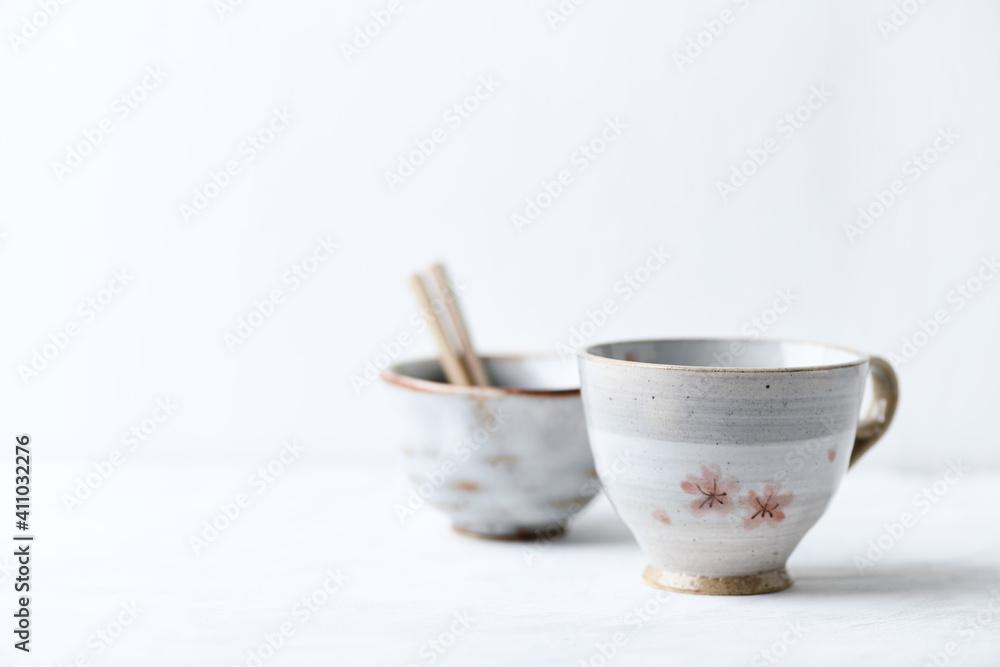 Fototapeta Traditional japanese ceramic on bright background. Copy space