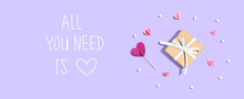 All You Need Is Love Message With A Small Gift Box And Paper Hearts